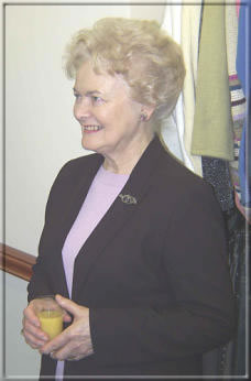 Nadene Crowther, who was responsible for establishing the six Hospice shops, looks on.