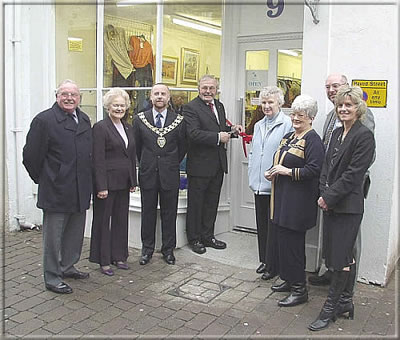 Hon. J. A. Brown SHK, MHK for Castletown performed the opening ceremony for the newly extended Hospice Shop at 9, Arbory Street, Castletown on Friday 24th January 2003. Those attending included the Chairman of Castletown Commissioners and Mrs Cringle, President of Hospice, Mrs Nadene Crowther, Mr P. G. Collier, General Manager of Hospice and Mr Vickers, Chairman of Share the Care Ltd., together with other Directors.