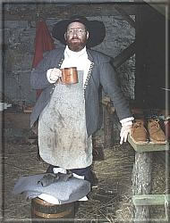 The cobbler takes a break and a swig of ale.